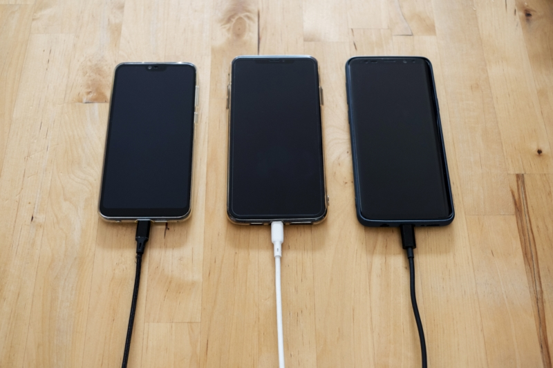 black-android-smartphones-on-brown-wooden-surface