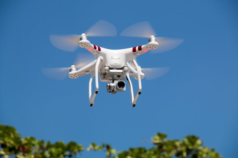 drone-flying-against-blue-sky